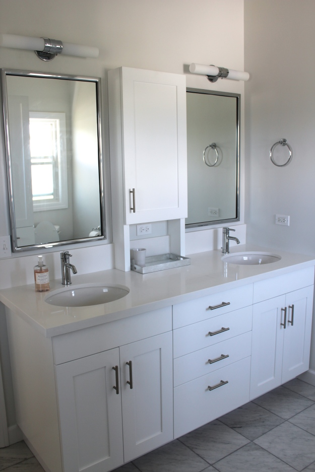 Here's a last look at the sink wall, where we added a second sink and a lot more storage!